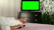 Stock Video Footage of Woman watches green screened TV