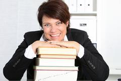 Dedicated hardworking professional woman Stock Photos