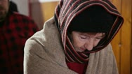 Stock Video Footage of Homeless and needy people, wrapped up warm against the cold are standing in line