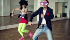 Couple dancing funky, funny dance in ballroom, steadicam shot HD Stock Footage