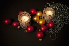 two candles with christmas-tree decoration - stock photo