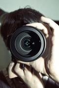 Men's hands held camera Stock Photos
