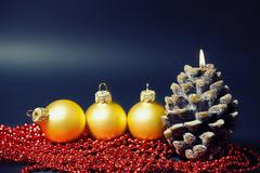 Christmas card with gold balls and candles Stock Photos