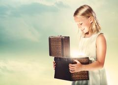 Blonde girl opening a treasure box Stock Photos