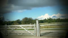 Time Lapse of a fence moved by the wind in the countryside - stock footage