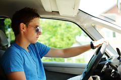 Young man driving a car Stock Photos