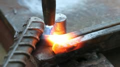 Gas heating cutting metal using torch and bending square bar Stock Footage