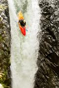 Stock Photo of Courageous Kayaker In A Vertical Diving Position