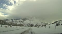 Winter snowy and cloudy day mountain road HD 0122 Stock Footage