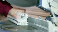 Stock Video Footage of Circular Saw Blade Cutting PVC Window Profile