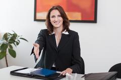 attractive businesswoman greets - stock photo