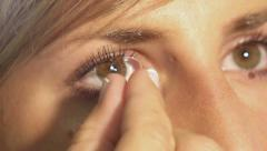 Contact lense removal - stock footage