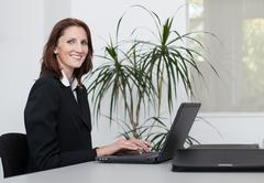Young businesswoman uses a notebook Stock Photos