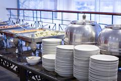 Buffet table with dishware Stock Photos