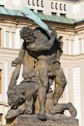 Hradcany castle and battling titan statue Stock Photos