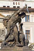 hradcany castle and battling titan statue - stock photo
