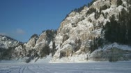 Beautiful cliffs and two snowmobiles Stock Footage