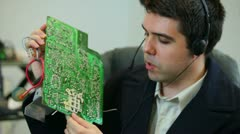 Engineer discussing electronics over headset Stock Footage