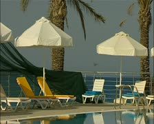 Hotel pool area at a hotel north of Famagusta Cyprus tilt to water reflection Stock Footage
