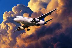 jet aircraft in a sunset sky - stock photo