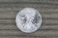 Pure silver dollar on faded wood Stock Photos