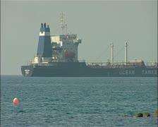 Cargo ship, Water transport ship southern Cyprus close pan 16:9 PAL Stock Footage