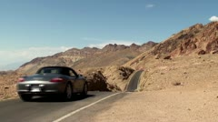 Sport car on Artists Drive road at Death Valley NP. California-Nevada, USA. - stock footage