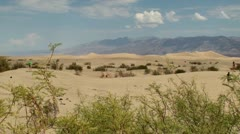 Tourists at Sand dunes at Death Valley NP. Stovepipe Wells, USA. - stock footage