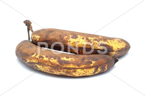 Stock photo of two old bananas
