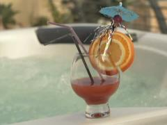 Tasty alcohol cocktail by the jacuzzi, super slow motion, shot at 240fps NTSC Stock Footage