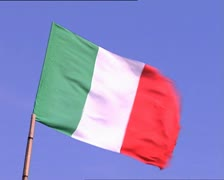 Italian flag on a blue sky background - stock footage