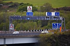 motorway gantry sign at elevated junction 42 of M4 in South Wales - stock photo