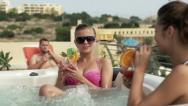 Girlfriends with cocktails in jacuzzi, super slow motion, shot at 240fps HD Stock Footage