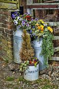 Farmyard cotainers with flowers Stock Photos