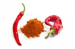 red paprika pepper with chili peppers isolated on white - stock photo