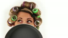 Funny Housewife with hair curlers shoots with eyes Stock Footage