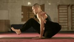 Young Yoga man doing Flexible Exercise in the Sport Gym Stock Footage