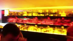 Timelapse of bar in night club shot as if the person was drunk or had drugs - stock footage
