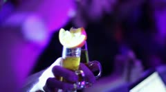 Hand holding cocktails for dj during the party in night club Stock Footage
