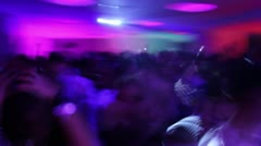 Low frame rate shot of people dancing having fun in night club. Teenage crowd Stock Footage