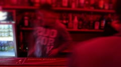 Bartender in night club is serving alcohol drinks, vodka cocktails Stock Footage