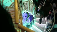 Tripod shot of people walking up and down the steel winding staircase. Stock Footage