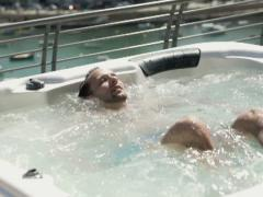 Happy man relaxing in jacuzzi, super slow motion, shot at 240fps NTSC Stock Footage