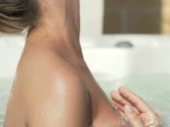 Woman body in jacuzzi, super slow motion, shot at 240fps NTSC Stock Footage