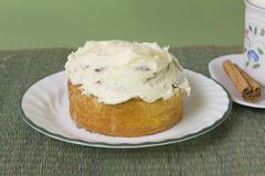 Cream cheese iced cinnamon roll Stock Photos