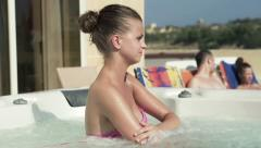 Beautiful woman in jacuzzi, super slow motion, shot at 240fps HD Stock Footage