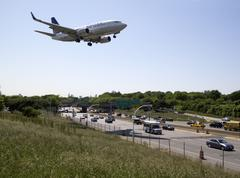 Plane lands low over freeway - stock photo