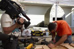 Camera Operator shoots carpenter Stock Photos