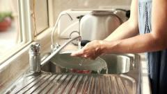 Woman washing plate in kitchen sink, super slow motion, shot at 240fps HD Stock Footage