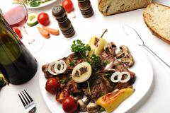 Delicious prepared and decorated food on table at home Stock Photos